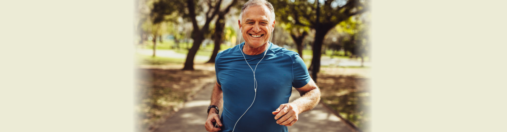 a man wearing earphones while jogging