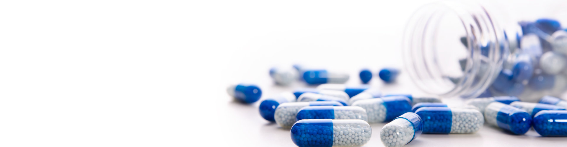 Pile of scattered capsules on a white background.